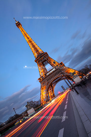 France, Paris, Eiffel tower with car s light tracks