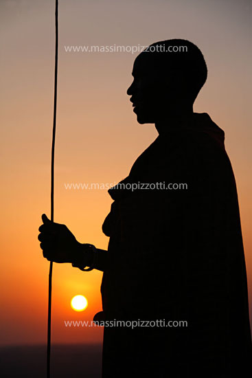 Tanzania, Ngorongoro, Masaai man at sunset