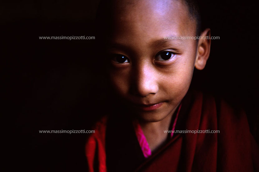 Bhutan, Paro, A child monk in the dark