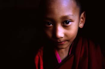 <b>Bhutan, Paro</b>, A child monk in the dark