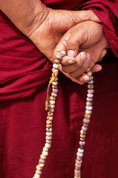 <b>India, Leh</b>, Monk Hands with rosary
