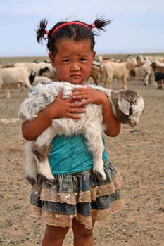 <b>Mongolia, Gobi Desert</b>, Young girl with a lamb